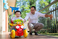 Father and baby playing Royalty Free Stock Image