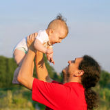 Father and baby playing outdoors. Royalty Free Stock Photo