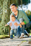 Father and baby play on the grass Royalty Free Stock Photo