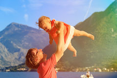 Father and baby playing on summer vacation Royalty Free Stock Photos