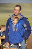 Father and baby in pouch attending July 4 dinner at ranch in Centennial Valley, MT Stock Photography