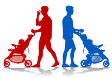 Father with baby and pram. Father walking with a baby in a stroller Stock Photos
