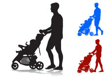 Father with baby and pram. Father walking with a baby in a stroller Stock Images