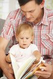 Father and baby reading book Royalty Free Stock Photography