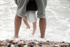 Father and baby sea wading Stock Photography