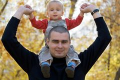 Father with baby on shoulders Stock Photo