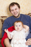Father and baby sitting together Royalty Free Stock Image