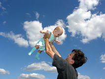 Father with baby in sky. Clouds royalty free stock photos