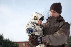 Father and baby in snow Stock Photography