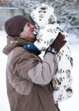 Father and baby in snow Stock Photos