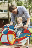 Father and baby son have fun at playground Royalty Free Stock Photography