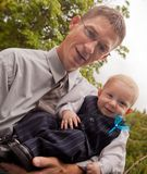 Father and baby son in fancy clothes Royalty Free Stock Images