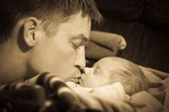 Father kissing infant baby son Royalty Free Stock Images