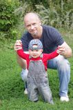 Father and baby son outdoors Stock Photo
