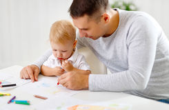 Father and baby son paint together Stock Images