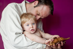 Father and baby son playing Royalty Free Stock Images