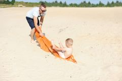 Father and baby son playing at beach.  royalty free stock photos