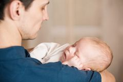 Father with baby Stock Images