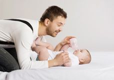 Father and baby. Young father is feeding his baby daughter Stock Photography