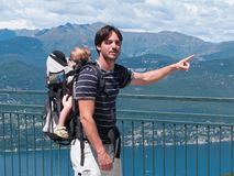 Father with backpack carries children during an excursion Royalty Free Stock Photo