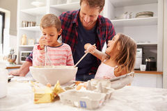 Father baking with children Royalty Free Stock Photo