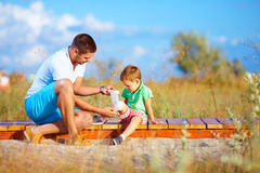 Father bandaging injured leg of kid Royalty Free Stock Photo