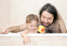 Father bathing together with his baby-boy Royalty Free Stock Images