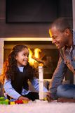Father and beautiful daughter playing at home Stock Image