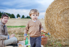 Father and beautiful toddler boy making  summer picnic Royalty Free Stock Image