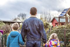 Father being an everyday superhero guiding and helping son and daughter.  Royalty Free Stock Photos