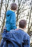 Father being an everyday superhero guiding and helping son and daughter.  Stock Images