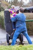 Father being an everyday superhero helping daughter to climb.  Royalty Free Stock Images