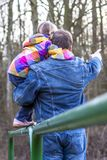 Father being an everyday superhero helping daughter to climb.  Stock Photography