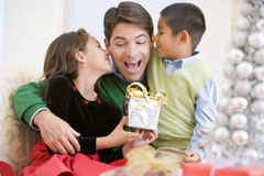 Father Being Given A Christmas Present. By His Daughter And Son Royalty Free Stock Images