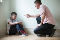 Father Being Physically Abusive Towards Son Royalty Free Stock Image