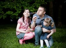 Father Blowing Bubbles Royalty Free Stock Image