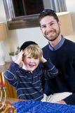 Father and boy celebrating Hanukkah. Affectionate father and 4 year old son celebrating Hanukkah