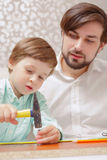 Father and boy with hammer Stock Image