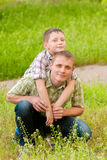 Father and boy in nature Stock Photography