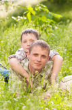 Father and boy in nature Stock Photos