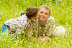Father and boy in nature Stock Photo
