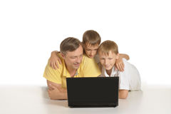 Father with boys with laptop Stock Photos