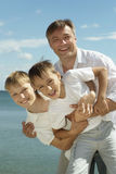 Father and boys at sea Royalty Free Stock Photos