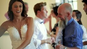 Dancing With Dad On Her Wedding Day. Father and bride dancing together on her wedding day with all of the other guests stock video footage