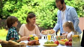 Father bringing just delivered pizza to hungry family, smelling fragrant food stock photos