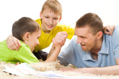 Father and brothers on the carpet Royalty Free Stock Image