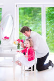 Father brushing hair of his adorable daughter Royalty Free Stock Photo