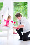 Father brushing hair of his sweet daughter Stock Photography