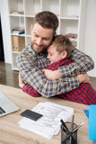 Father businessman hugs his son. At home office stock image