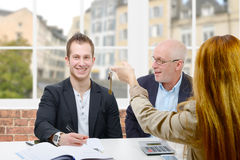 Father buy an apartment for his son. A father buy an apartment for his son royalty free stock images